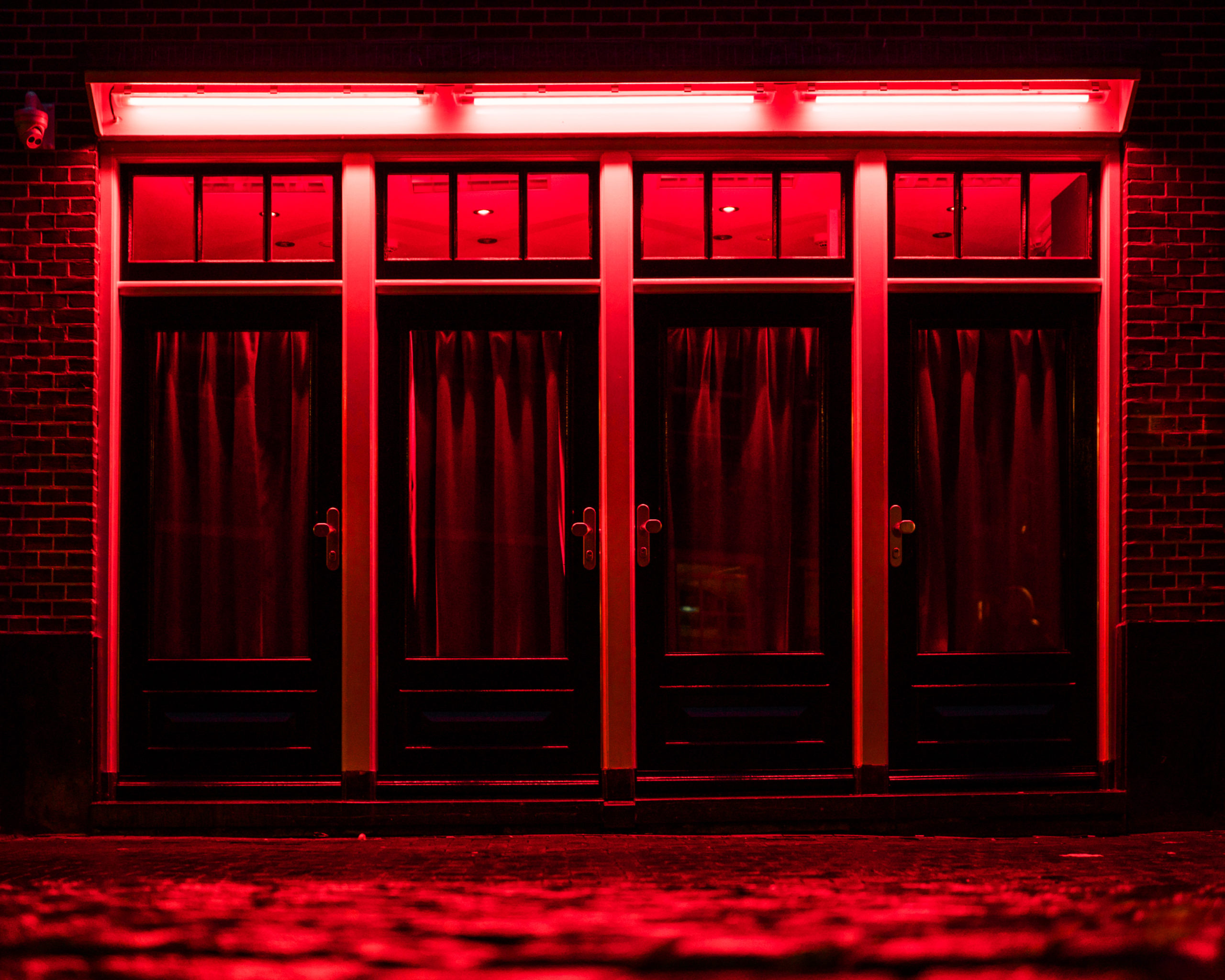 prostitution sex work depenalisation legalisation amsterdam red lights district