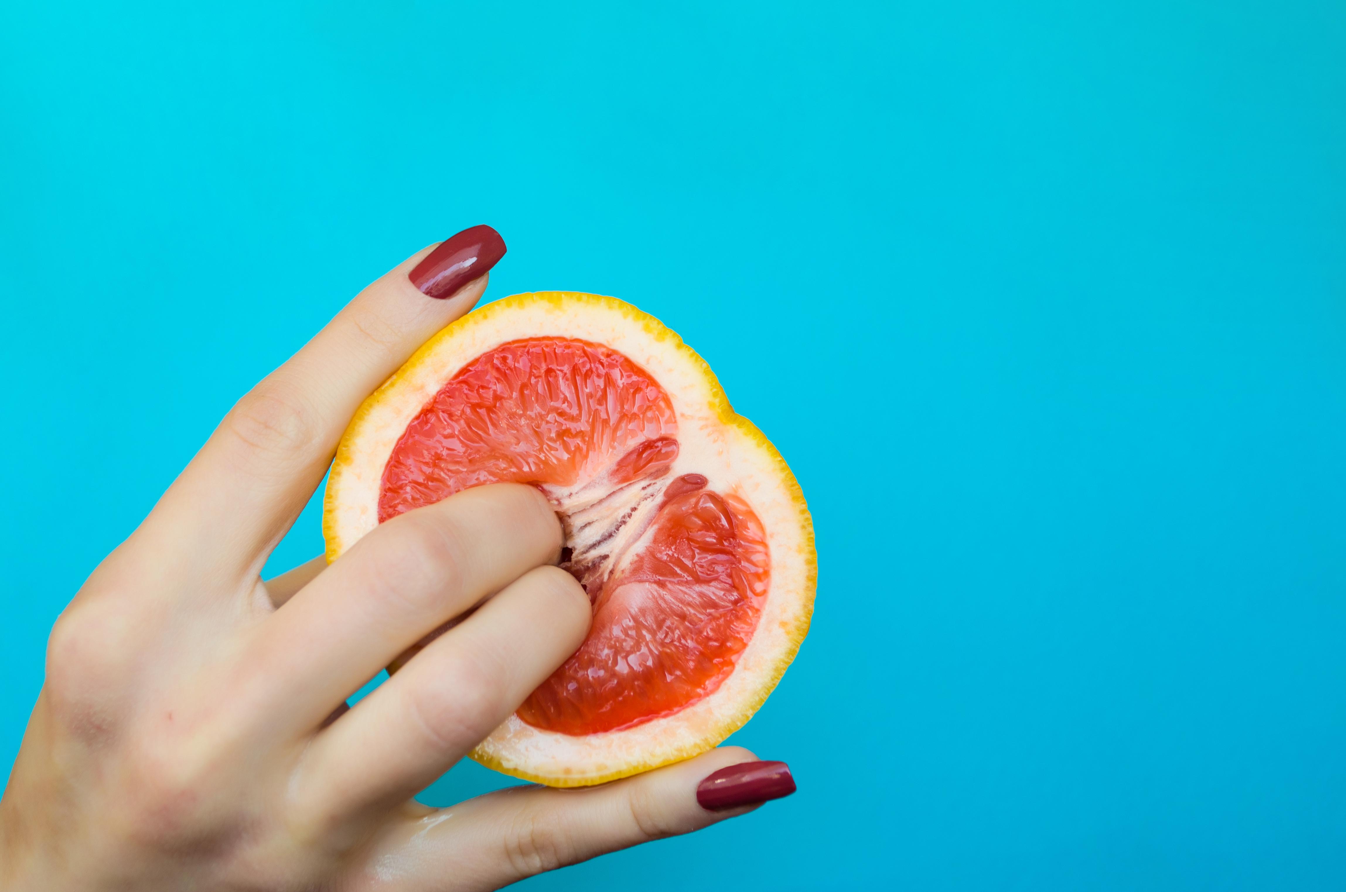 fingers on fruit